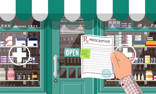 Magasin de pharmacie de façade avec porte