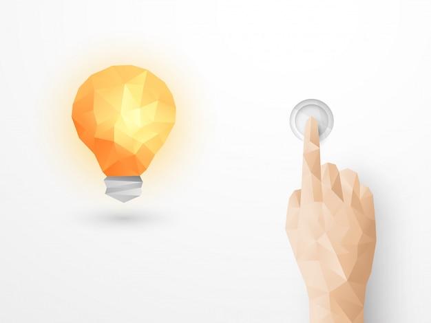 Main appuyant sur l'interrupteur de la lumière allumant ampoule rougeoyante