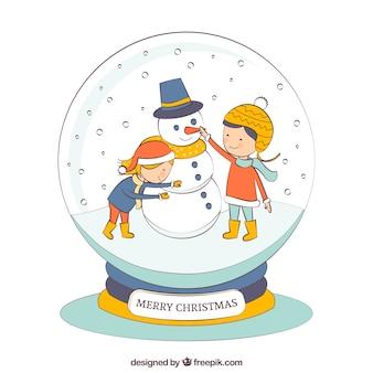 Main bonhomme dessiné et enfants à l'intérieur d'un boules crytal