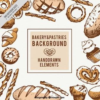 Main boulangerie dessinée et pâtisseries fond