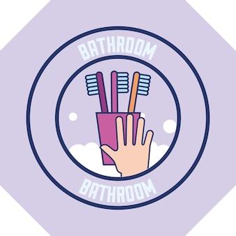 Main avec des brosses à dents en mousse propre badge salle de bain