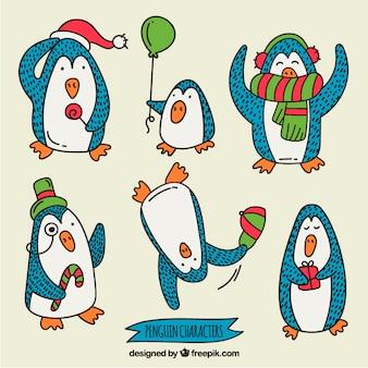 Main caricature dessinée pingouins de noël