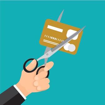 Main, carte de crédit de coupe d'affaires avec des ciseaux.