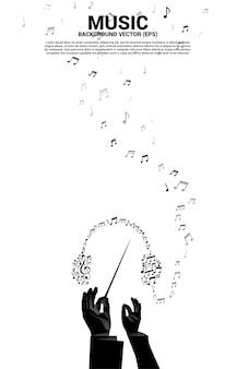 Main de chef d'orchestre avec la musique et le concept de fond sonore.