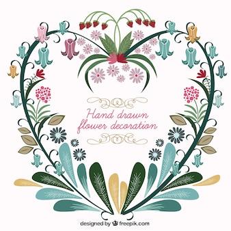 Main coeur dessiné composé de fleurs