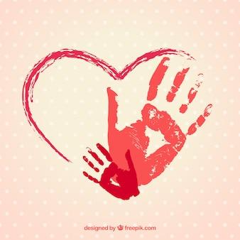 Main coeur peint avec des empreintes de mains