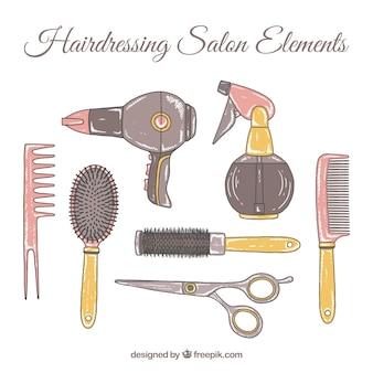 Main coiffure tirée collection d'accessoires de salon