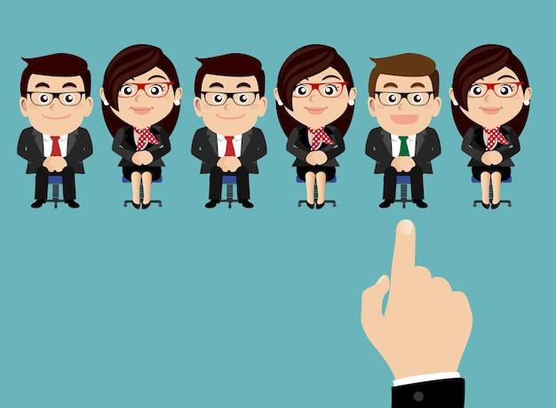 Main de concept de recrutement pointant vers les gens d'affaires
