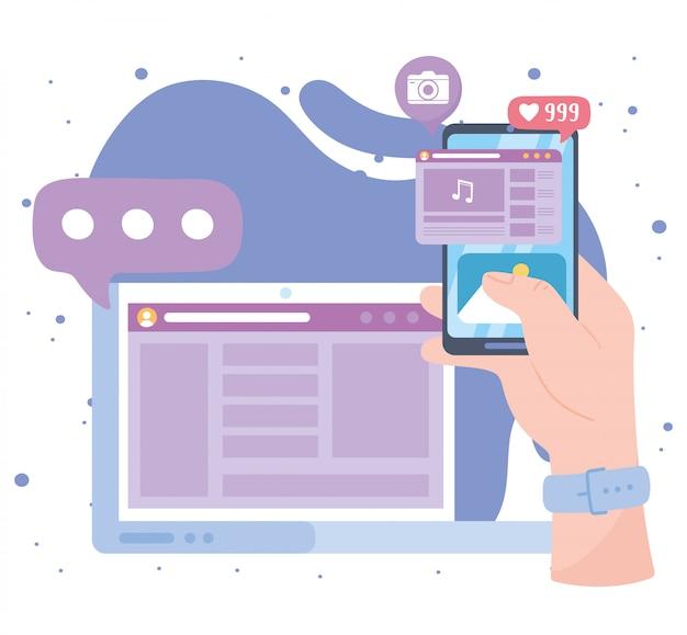 La main avec le contenu de l'ordinateur portable smartphone suit les technologies et la communication des réseaux sociaux de chat
