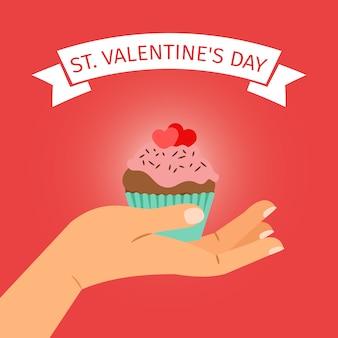 Main avec cupcake saint valentin