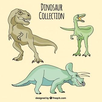 Main dessiné différents dinosaures