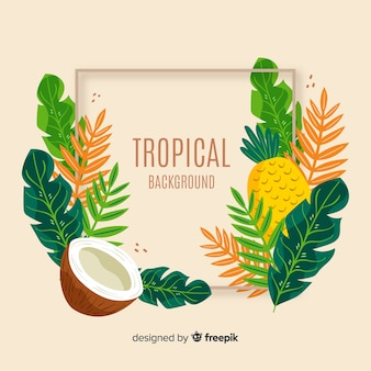 Main dessiné des feuilles tropicales sur fond de fruits
