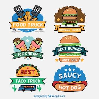 Main dessiné logos de camion alimentaire