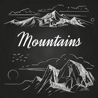 Main dessiné des paysages de montagnes sur tableau noir