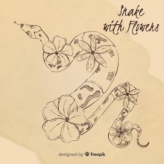 Main dessiné serpent sans couleur avec fond de fleurs