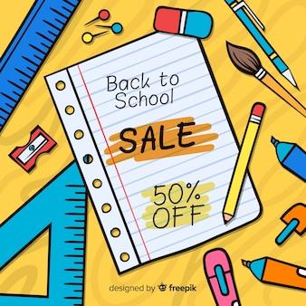 Main dessinée à l'arrière-plan des ventes de l'école