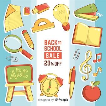 Main dessinée à l'arrière-plan des ventes scolaires