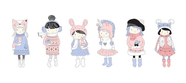 Main dessinée belle petite collection de filles d'hiver mignonnes.