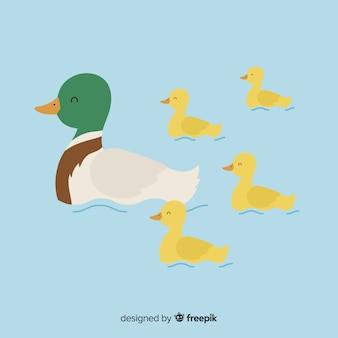 Main dessinée canard mère et canetons dans l'eau