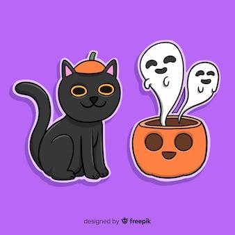 Main dessinée chat d'halloween et citrouille avec des fantômes
