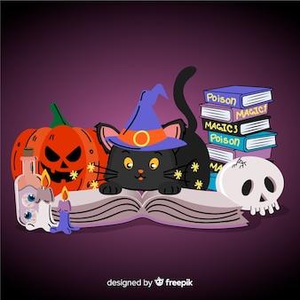 Main dessinée chat halloween avec des livres