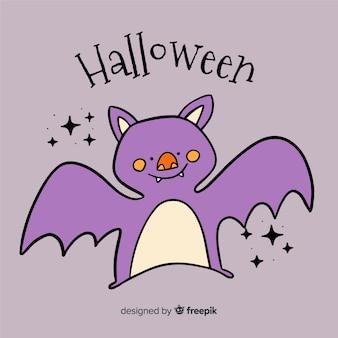 Main dessinée chauve-souris d'halloween mignon