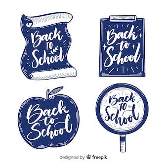 Main dessinée à la collection de badge école