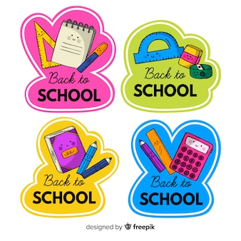 Main dessinée à la collection de badge école