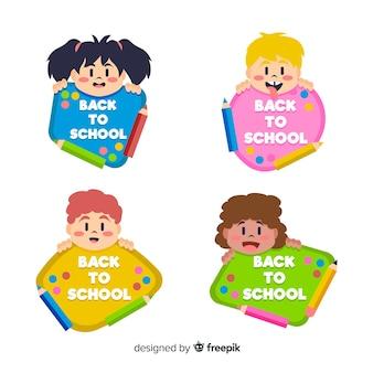 Main dessinée à la collection d'étiquettes de l'école