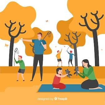 Main dessinée famille jouant dans la forêt