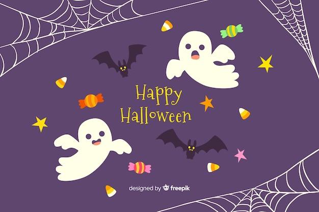 Main dessinée fond d'halloween avec des fantômes