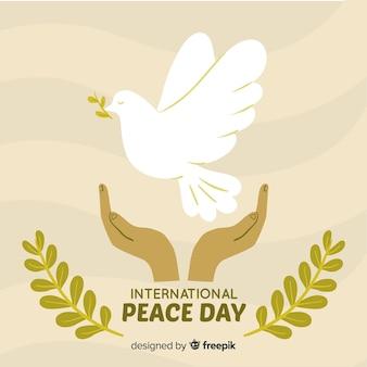 Main dessinée fond de jour de la paix avec la colombe