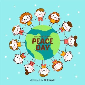 Main dessinée fond de jour de la paix avec les enfants