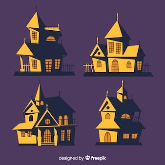 Main dessinée maison d'halloween avec des ombres