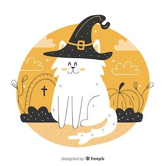 Main dessinée de mignon chat d'halloween