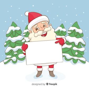 Main dessinée santa tenant une pancarte blanche