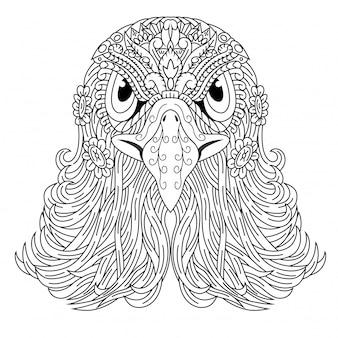Main dessinée de tête d'aigle dans un style zentangle
