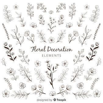 Main dessiner des éléments de décoration florale
