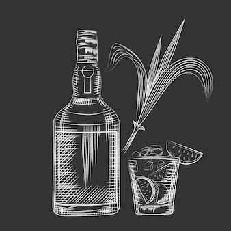 Main dessiner des feuilles de canne sur tableau noir.