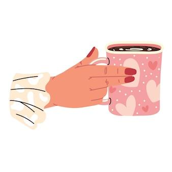 La main femelle tient la tasse de café