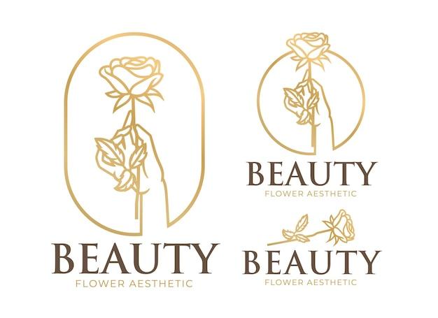 Main féminine tenant le modèle de logo de beauté fleur
