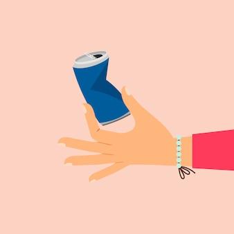 Main de femme tenant une canette d'aluminium cassée