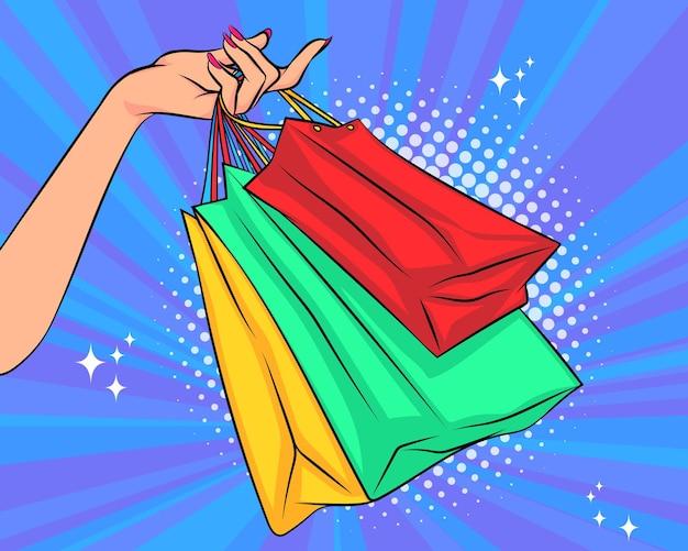 Main de femme tenant des sacs à provisions pop art comic style