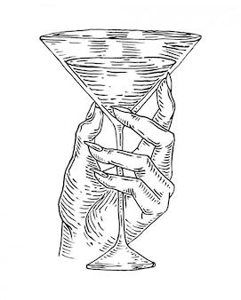 Main de femme tint un verre à cocktail, gravure illustration