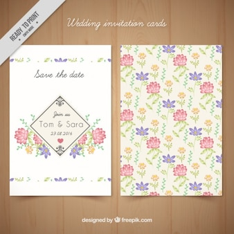 Main fleurs dessinées carte de mariage