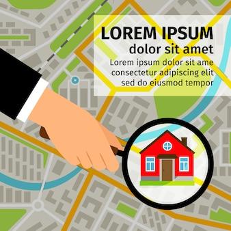 Main d'homme tenant une loupe et à la recherche d'une maison sur la carte