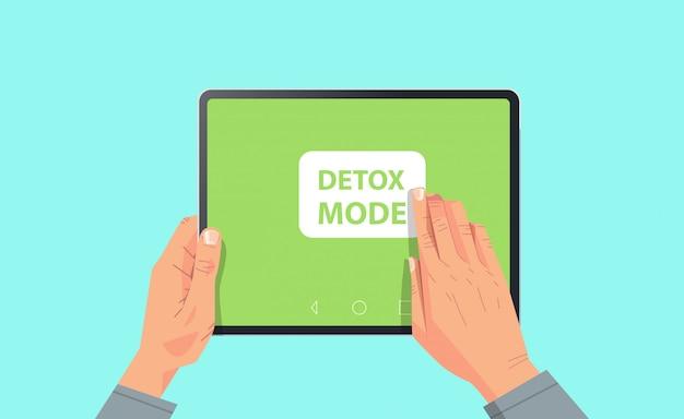 Main humaine appuyez sur le mode de désintoxication sur l'écran de la tablette concept de désintoxication numérique abandonnant internet et les réseaux sociaux illustration horizontale