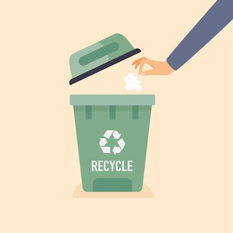 Main jeter le papier usagé dans la poubelle. concept de recyclage.