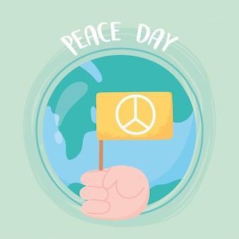 Main de la journée internationale de la paix avec illustration vectorielle de drapeau monde dessin animé