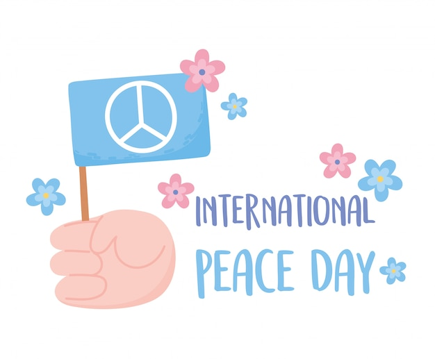 Main de la journée internationale de la paix tenant illustration vectorielle de drapeau fleurs carte
